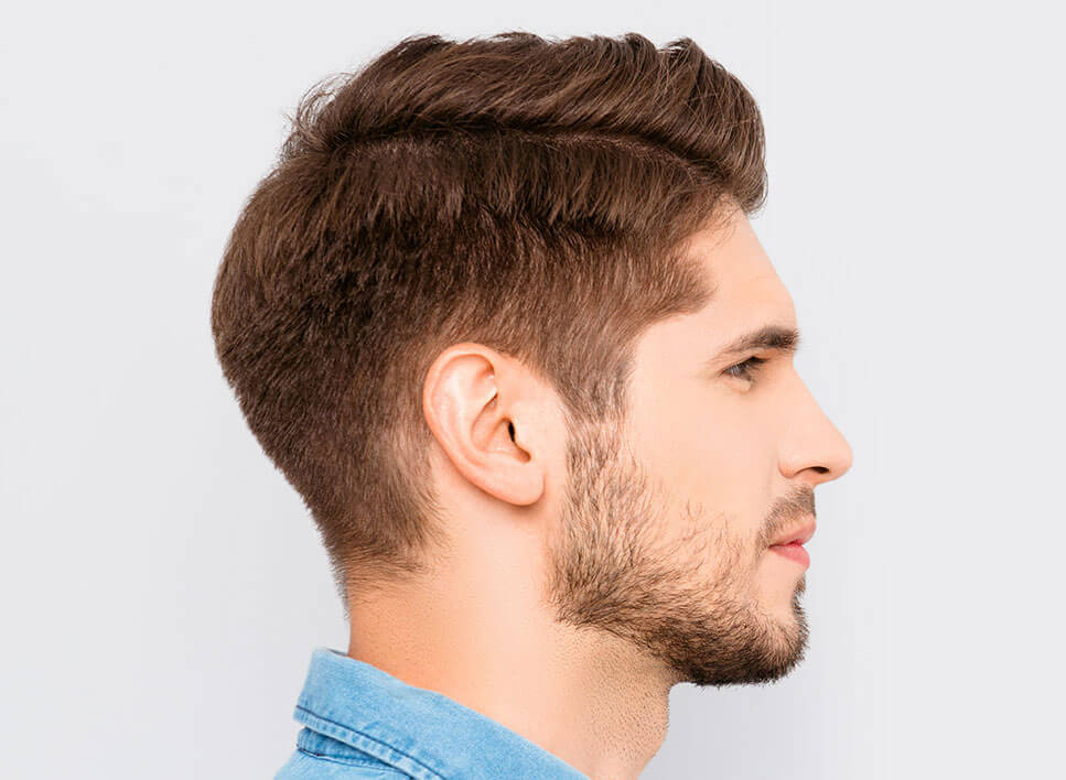 Profile of young man with beard